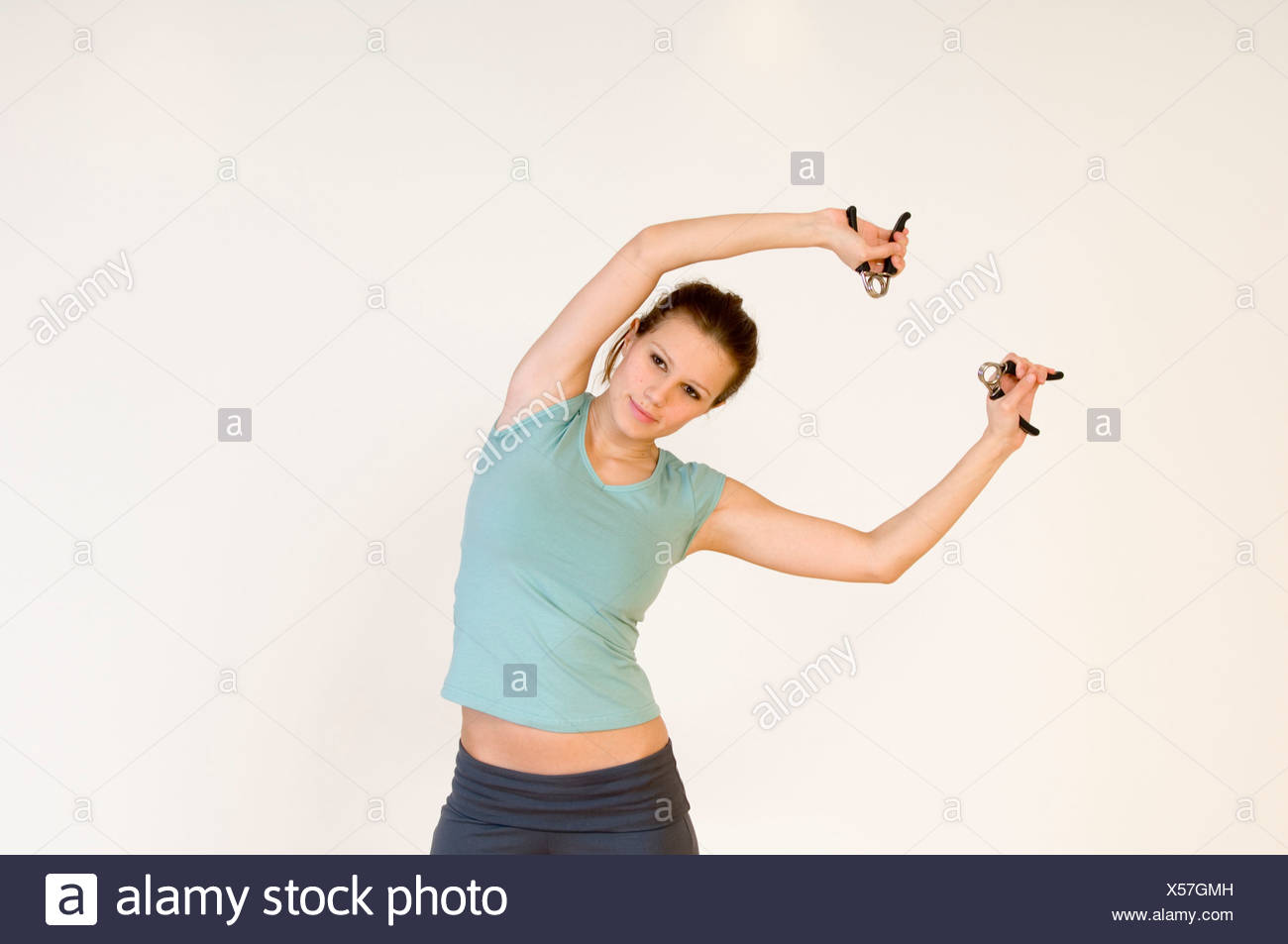 young woman making excercise with handgrip - Stock Image