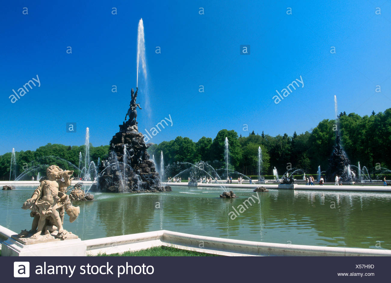 Reflection of trees in water, Herrenchiemsee Castle, Herreninsel, Bavaria, Germany - Stock Image