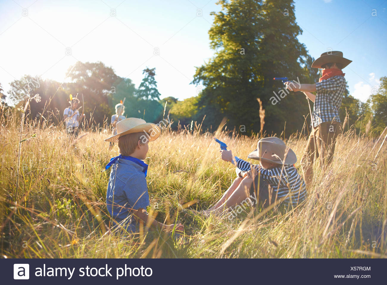 Group of young boys playing in a field - Stock Image