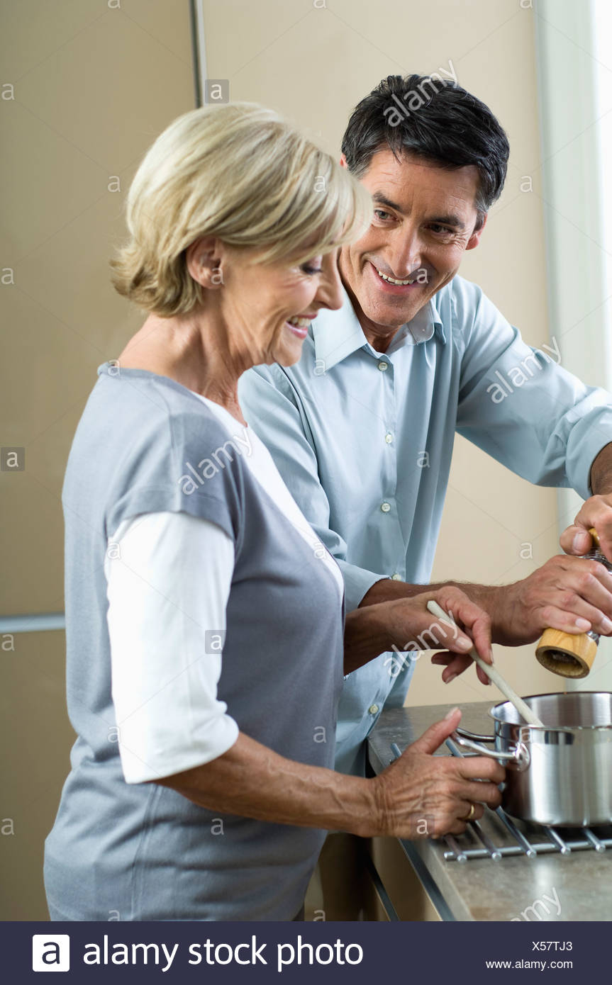 Couple cooking together - Stock Image
