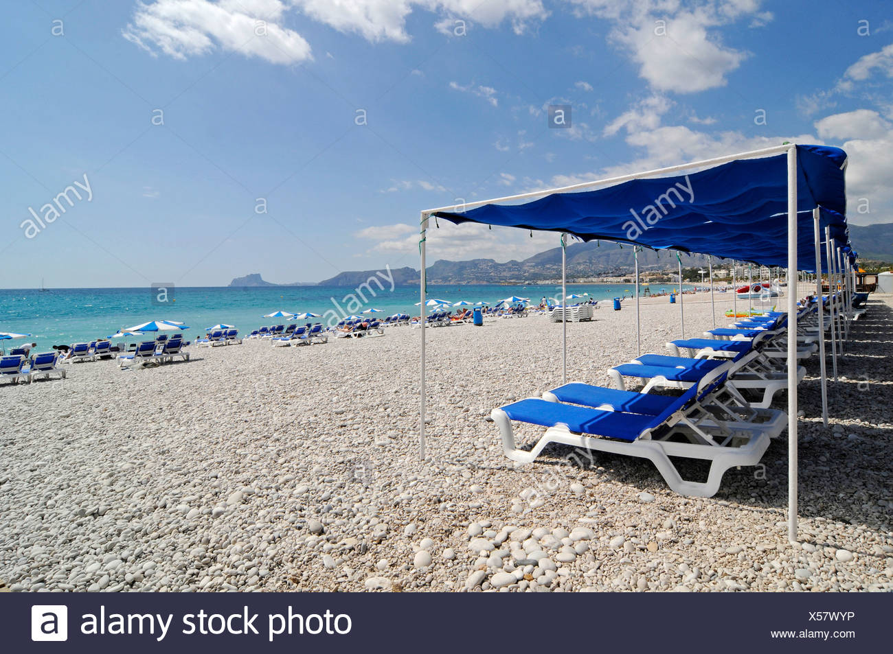 Empty blue chairs, umbrellas, pebble beach, Albir, Altea, Costa Blanca, Alicante, Spain, Europe Stock Photo