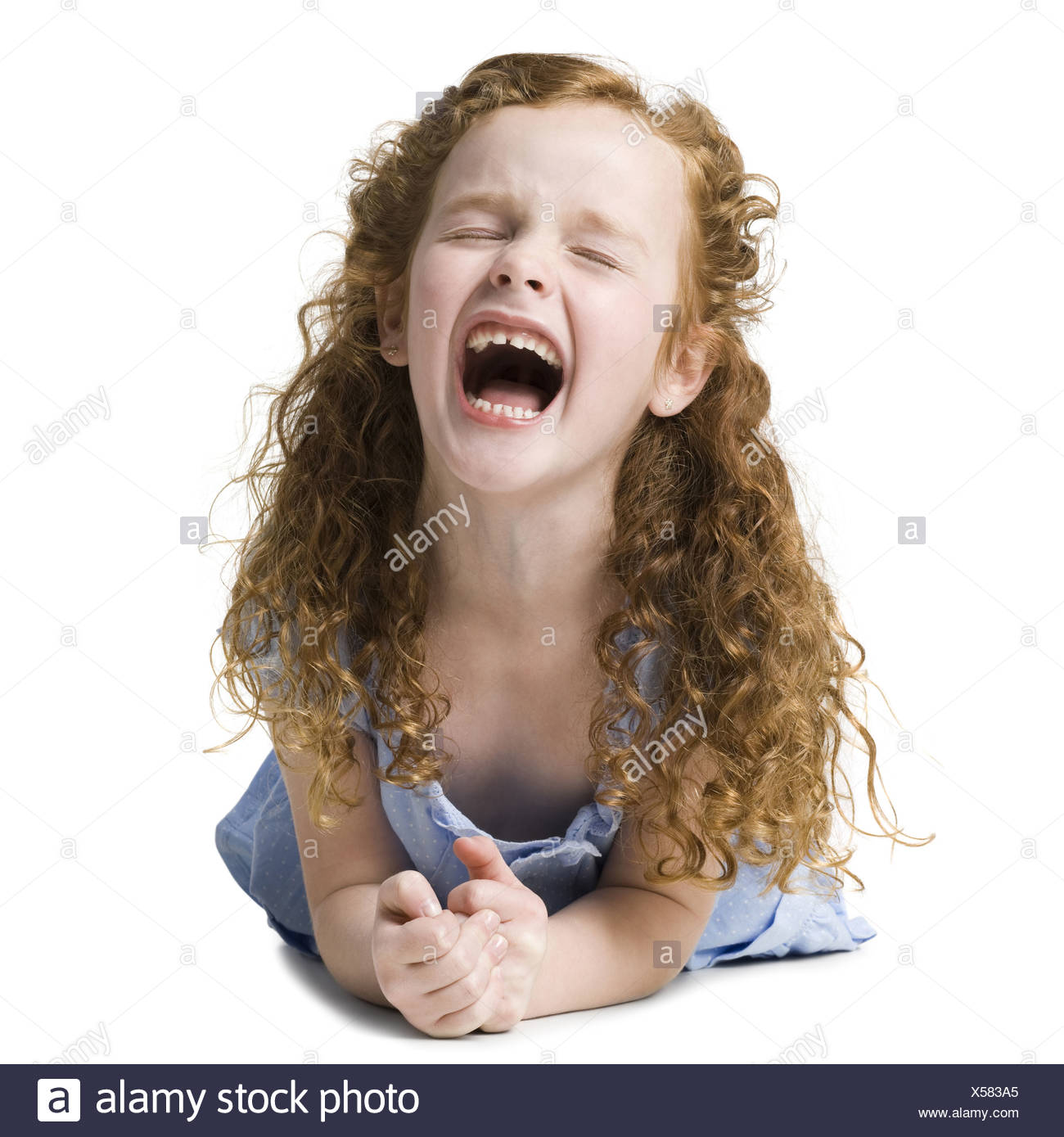 girl in a blue shirt - Stock Image