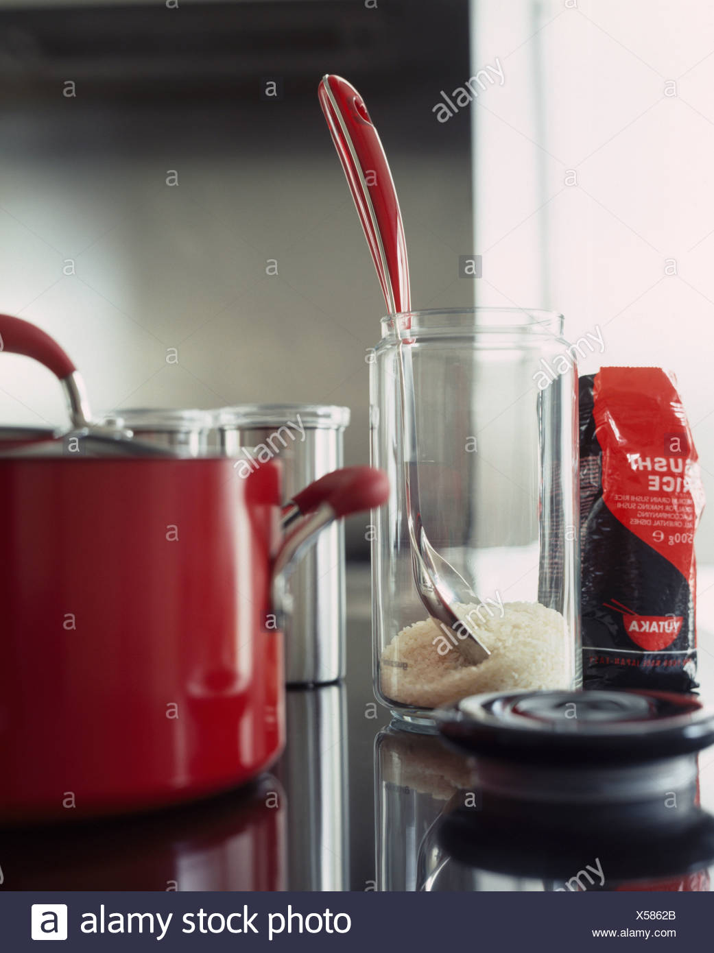Close Up Of Red Enamel Kettle With Glass Storage Jar