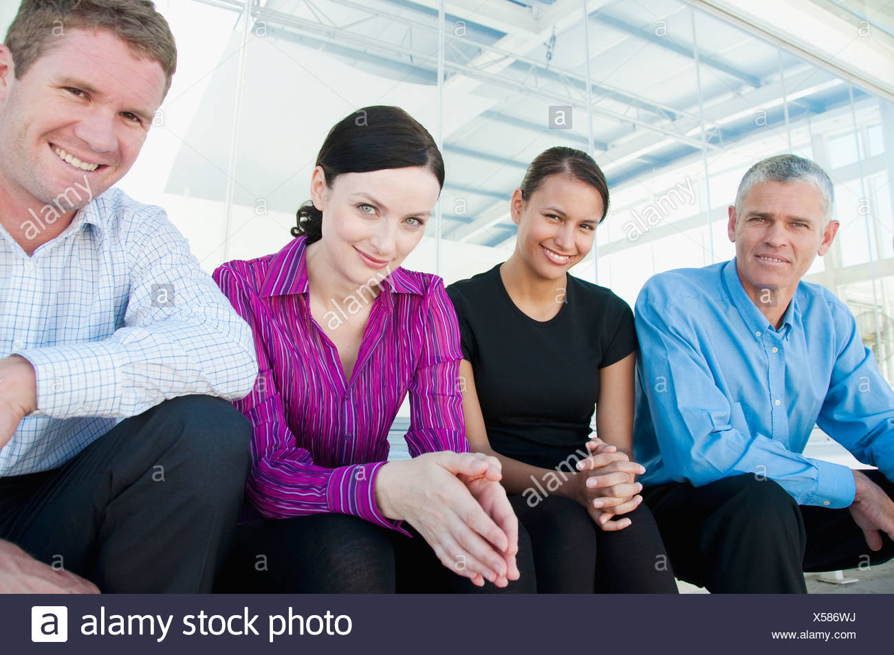 Four happy members of a business team - Stock Image