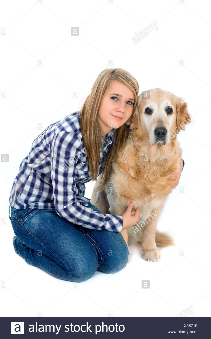 Young girl with pet dog isolated on white - Stock Image