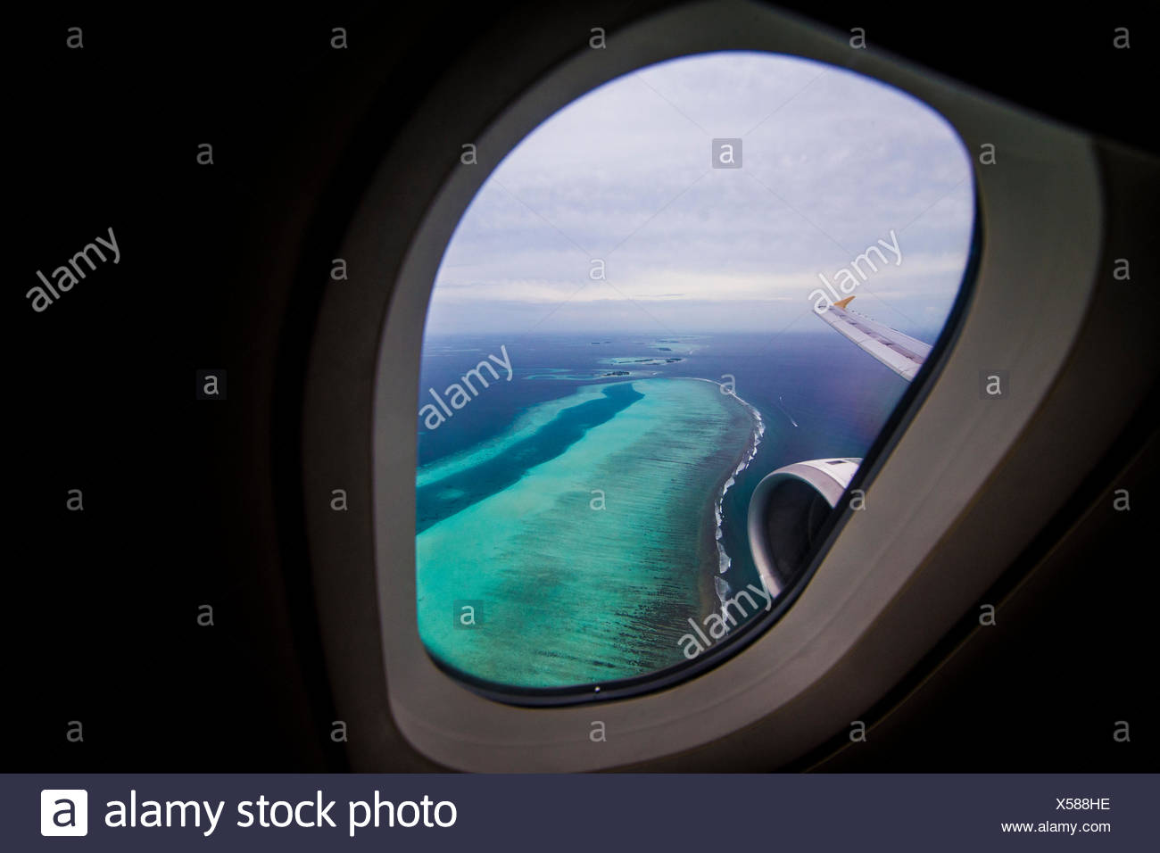 Maldives, Tropical islands seen from plane window - Stock Image