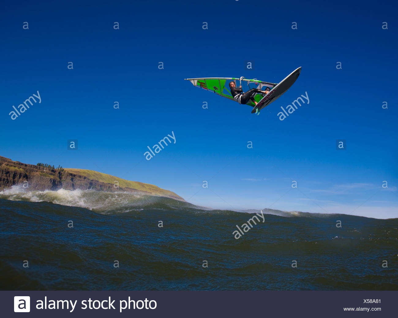 Windsurfer airs it out at The Wall. - Stock Image