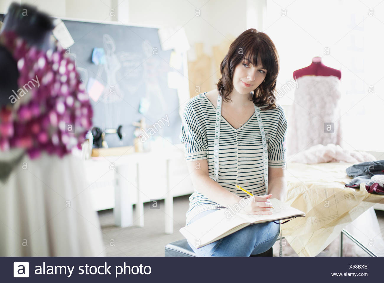 pretty, clothing designer doing some sketches - Stock Image