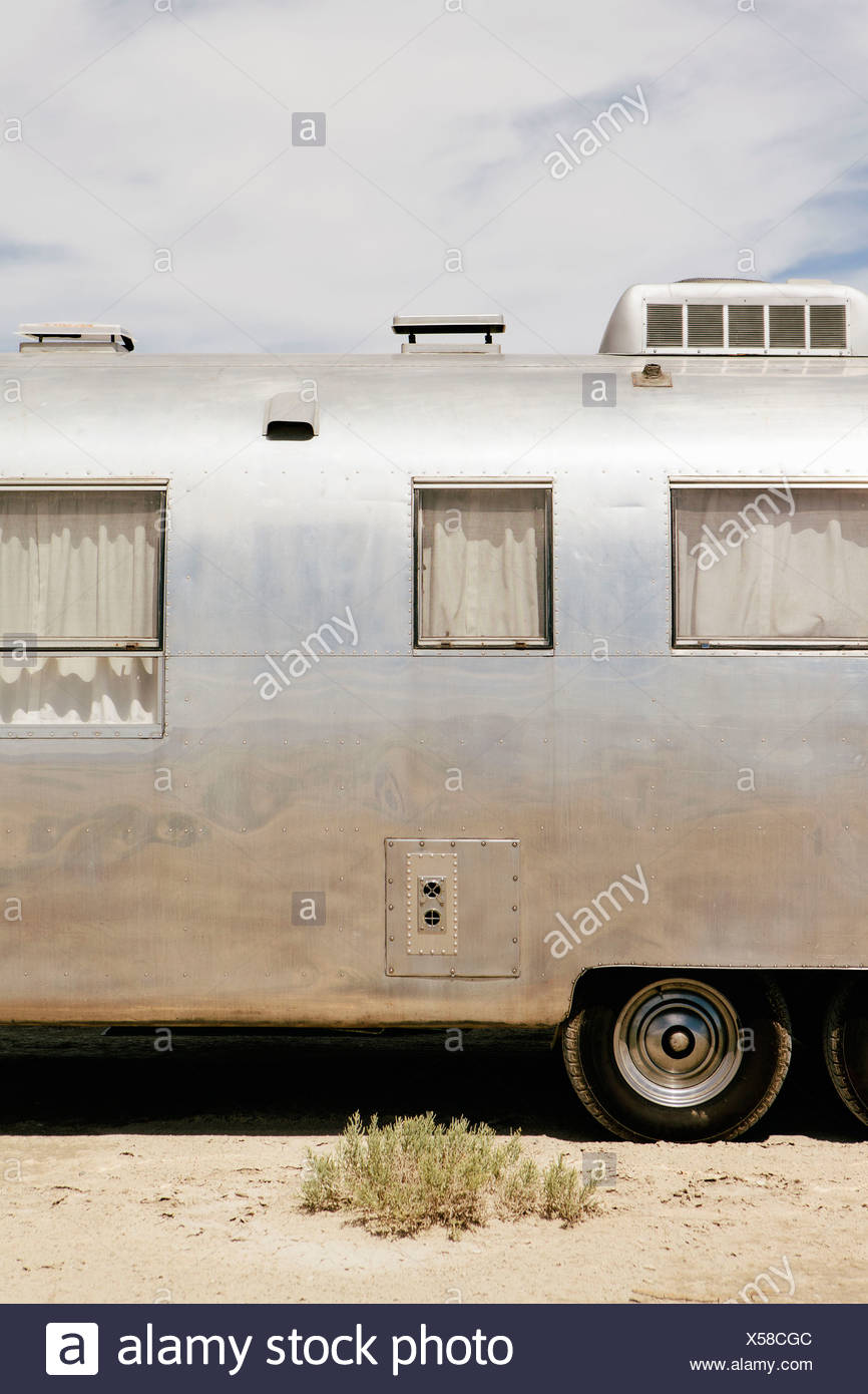 A vintage Airstream silver accommodation trailer parked on the Bonneville Salt Flats during Speed week. - Stock Image