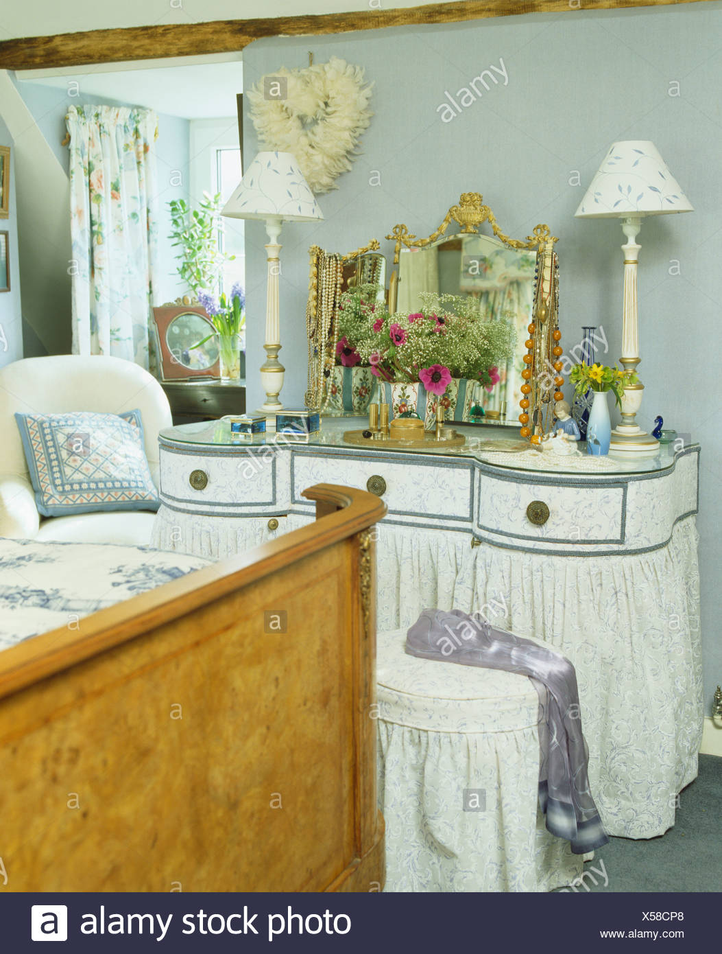 Picture of: Blue Gray Cottage Bedroom With White Lamps On Dressing Table With Skirted Bernard Thorpe Drapes And Antique Mirror Stock Photo Alamy