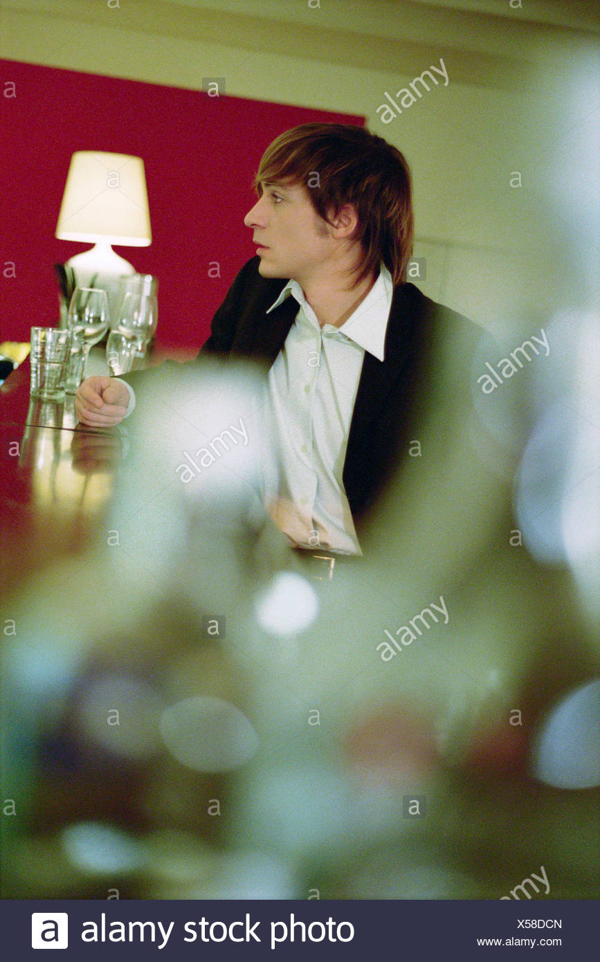Well dressed young man at bar Stock Photo