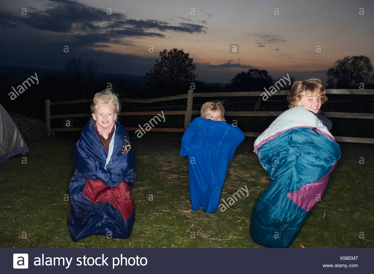 Sleeping bag races at dusk Stock Photo