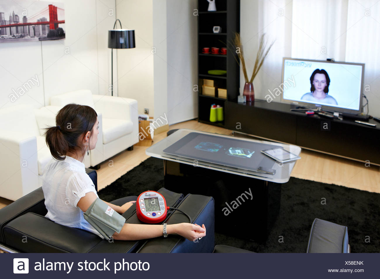 Telemedicine, taking blood pressure in home, Health and Biomedical applications, Vicomtech-IK4 Visual Interaction and - Stock Image