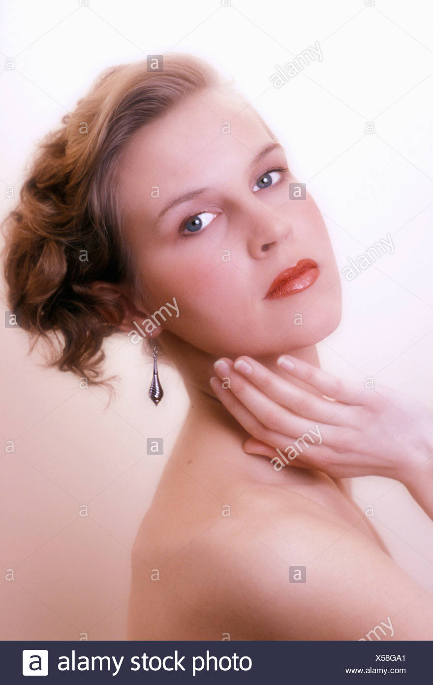 effect hair pinned up jewellery jewelry made up model released portrait pose posing soft focus studio wom - Stock Image
