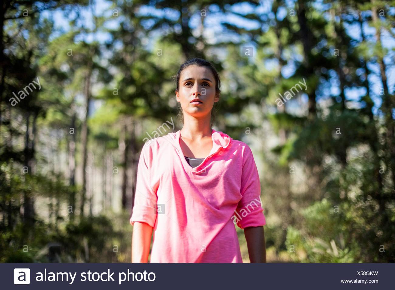 Woman unsmiling posing - Stock Image