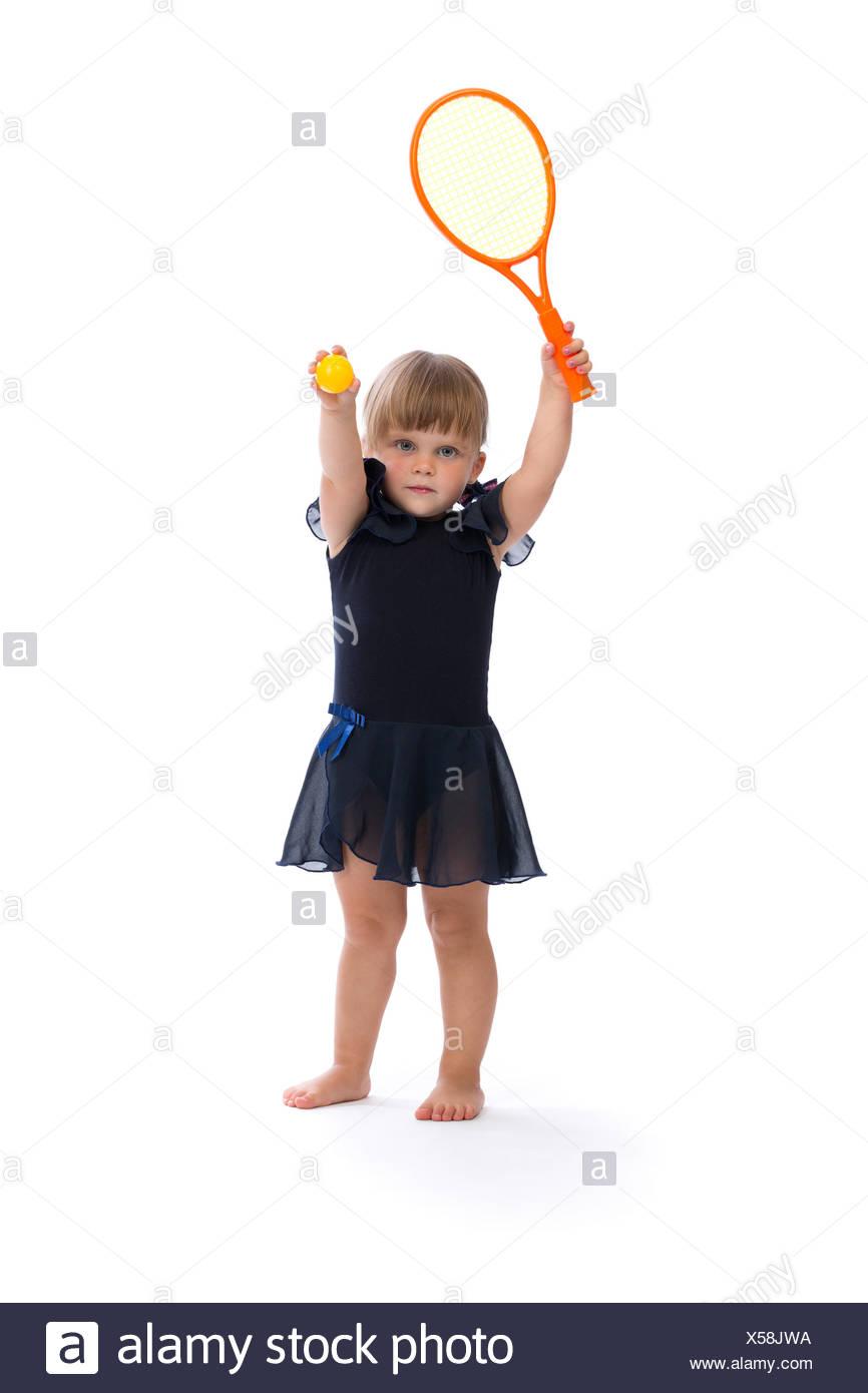 little girl playing tennis - Stock Image