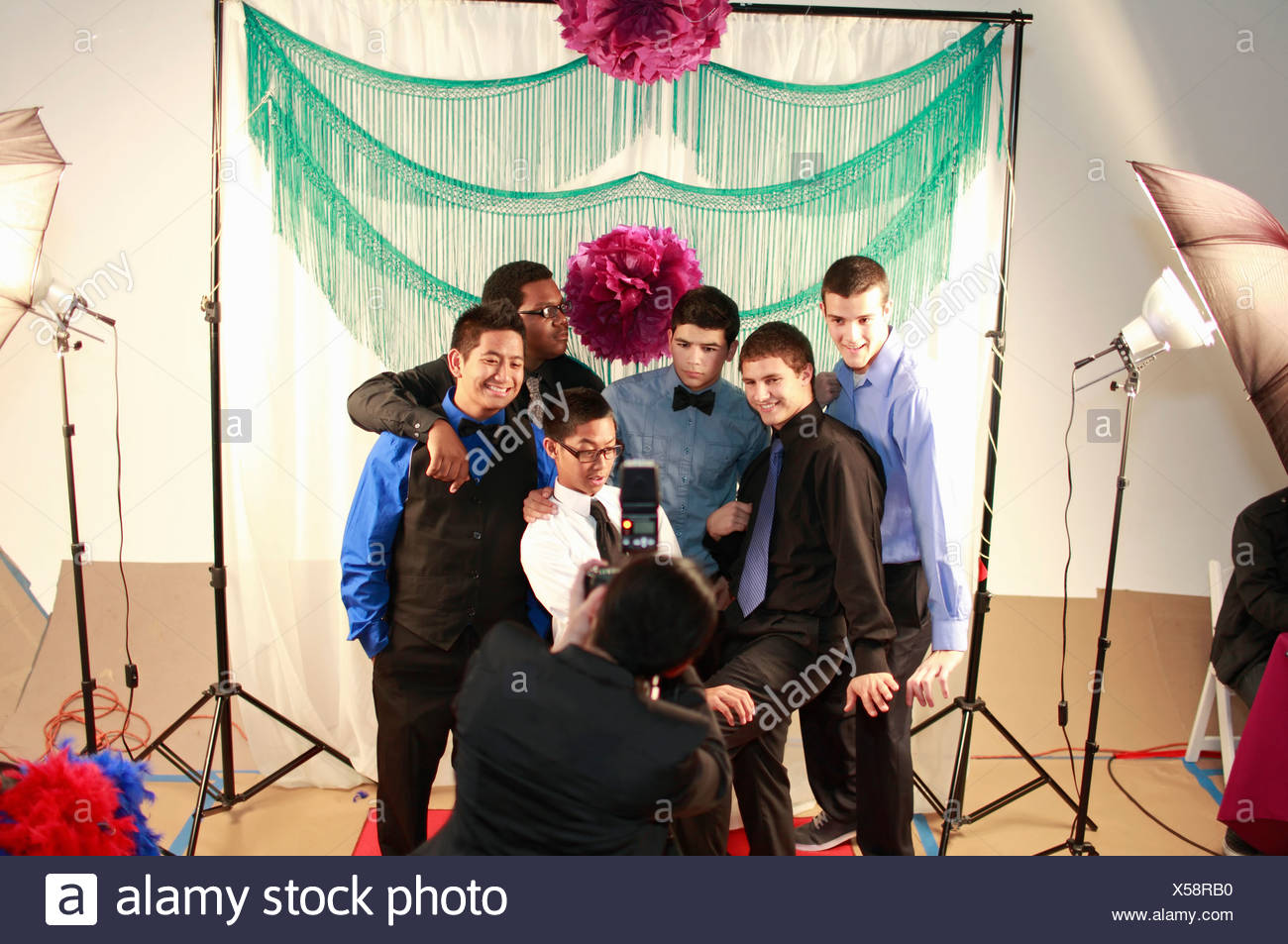 Teenagers posing for portrait at party - Stock Image