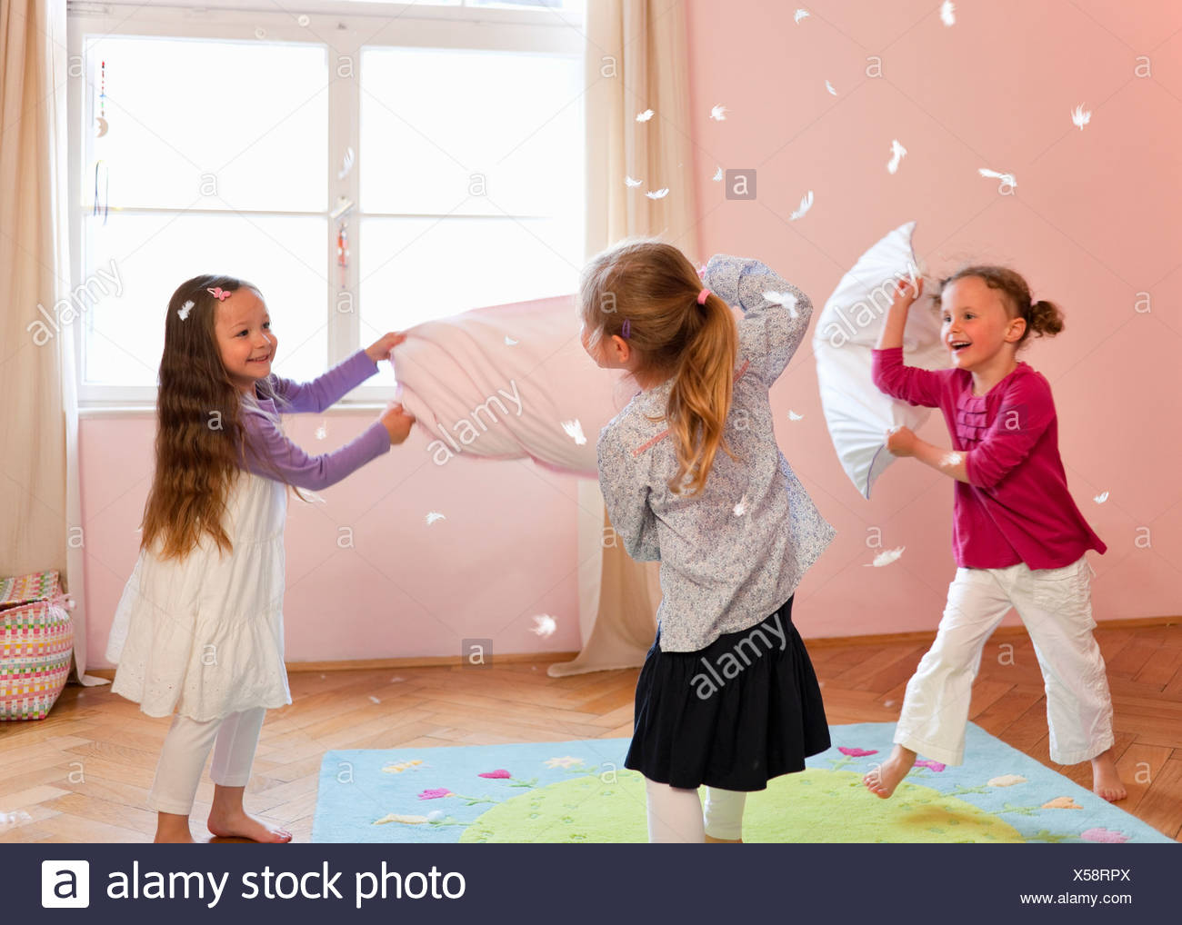Girls having a pillow fight Stock Photo
