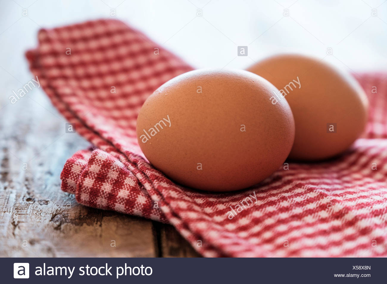 Eggs lying on tablecloth - Stock Image