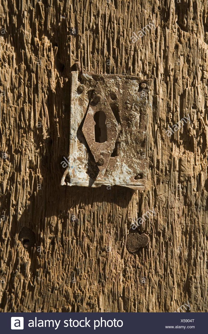 Saudi Arabia, Al Ula, front door, detail, door lock, al-Madina, door, lock, weather-beaten, old, rusty, key tin, close up, - Stock Image
