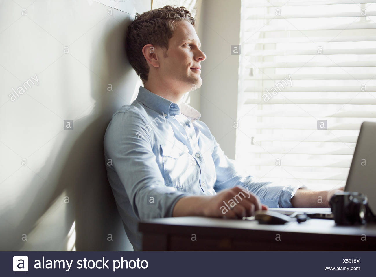 man reflecting at home Stock Photo