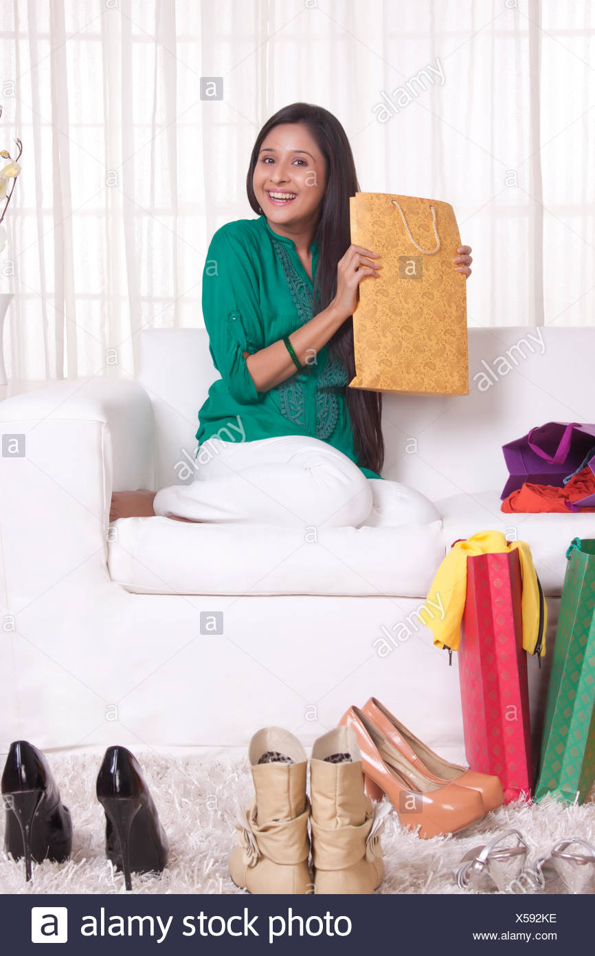 Young WOMEN with shopped goods - Stock Image