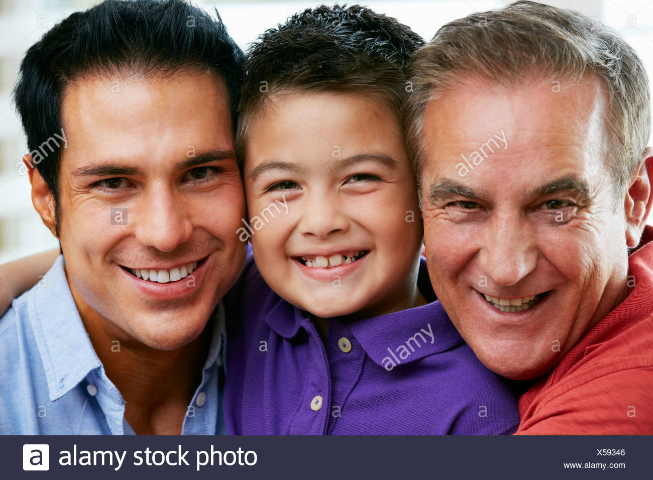 Male Members Of Multi Generation Family Relaxing At Home Together - Stock Image