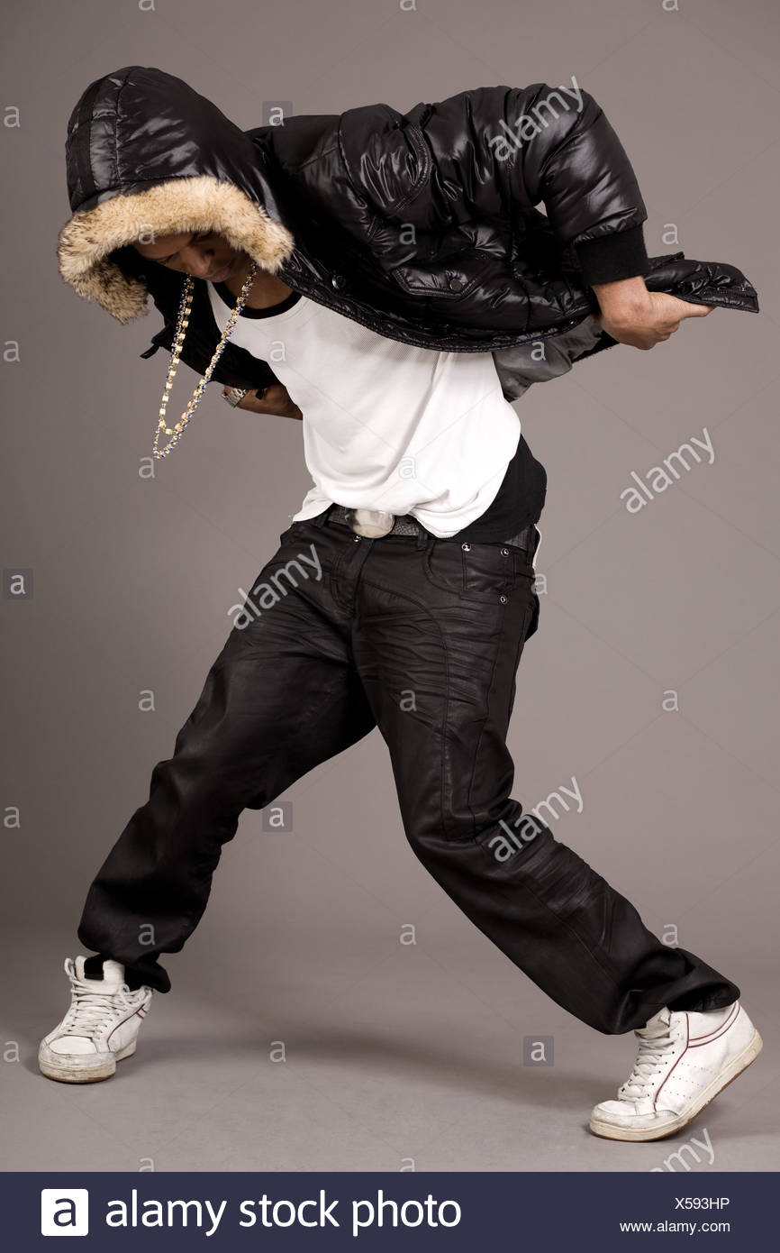 Man performs hip pop steps on grey background Stock Photo
