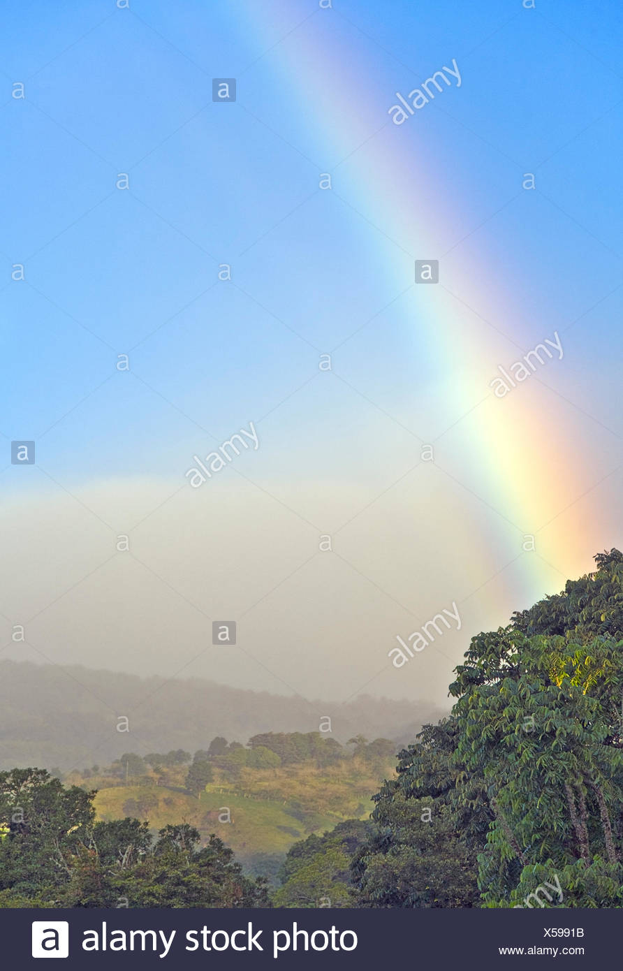 Rainbow over the Central Highlands after a rain, Alajuela Province, Costa Rica - Stock Image