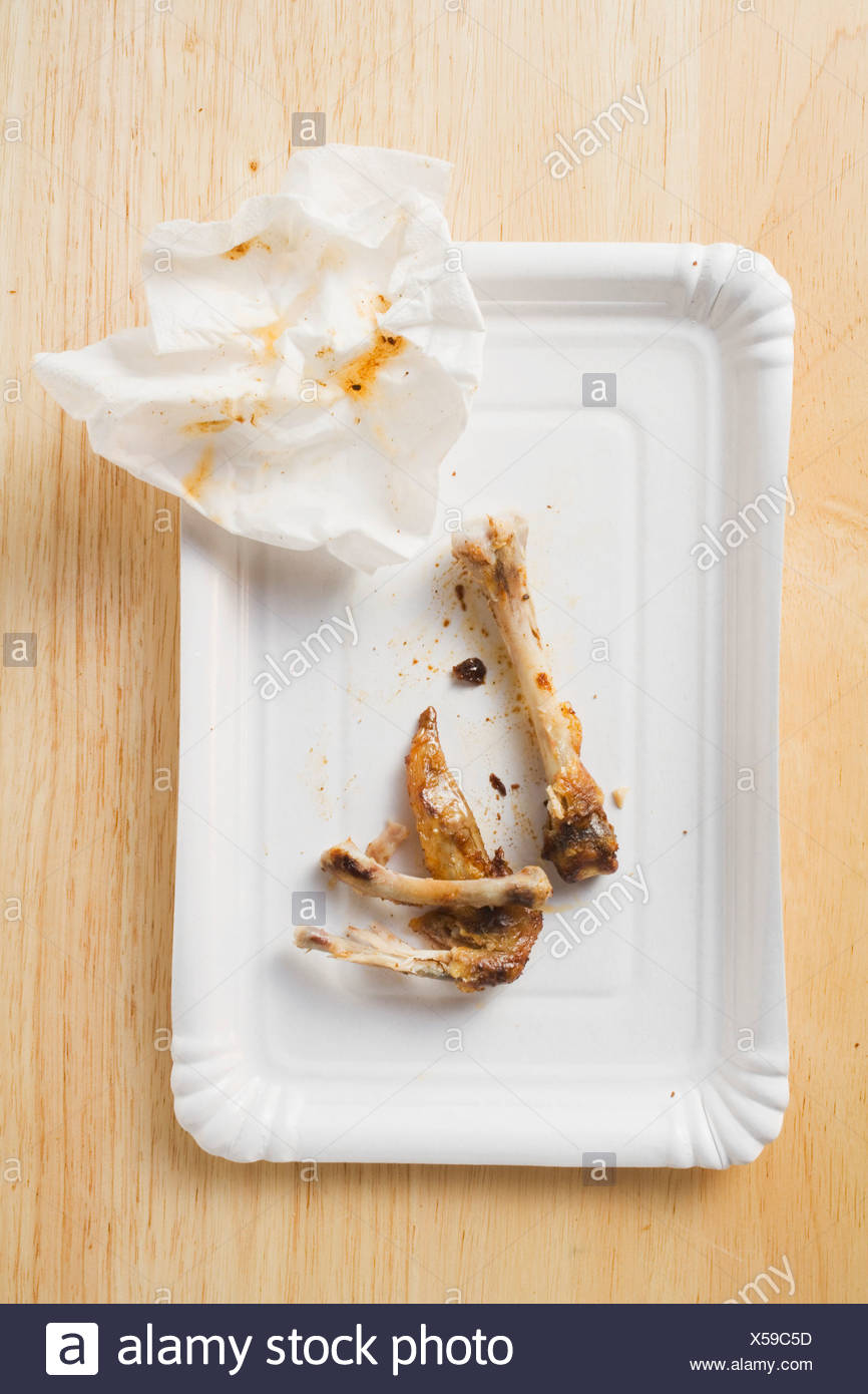 Chicken bones and paper napkin on paper plate FoodCollection & Chicken bones and paper napkin on paper plate FoodCollection Stock ...