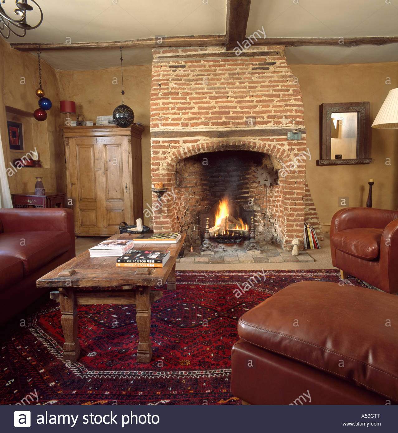 Lighted Fire In Exposed Brick Fireplace In Neutral Country