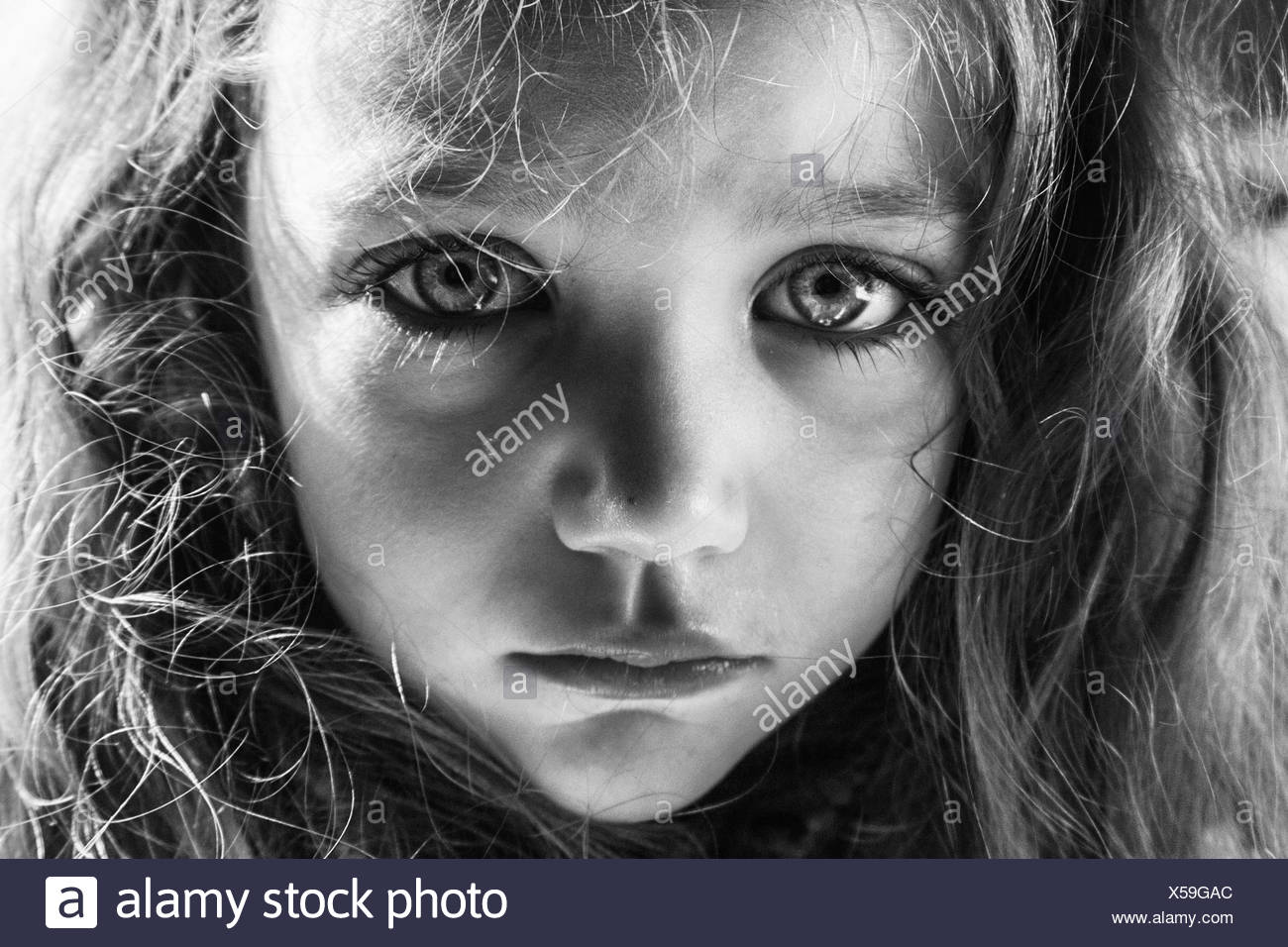 Girl with a tear running down her face - Stock Image