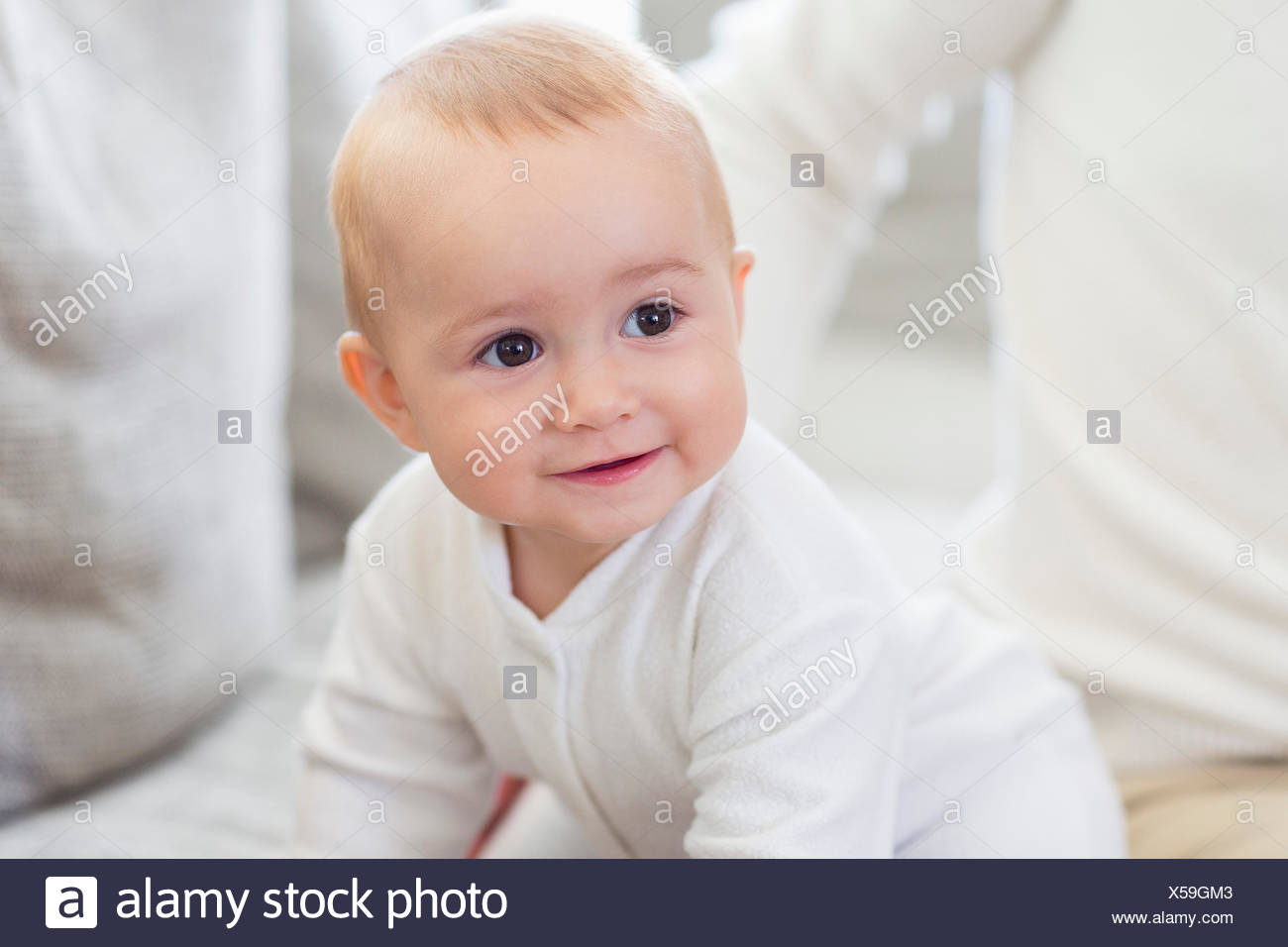 Happy baby girl with his father on couch - Stock Image