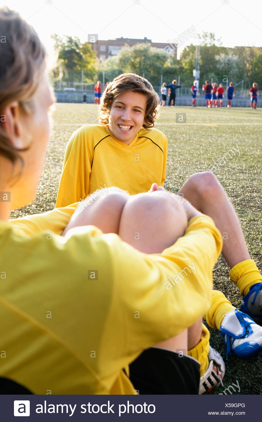Boys resting after practice - Stock Image