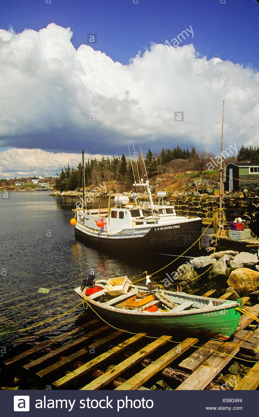 Fishing boats tied up at wharf, East Dover, Nova Scotia, Canada - Stock Image