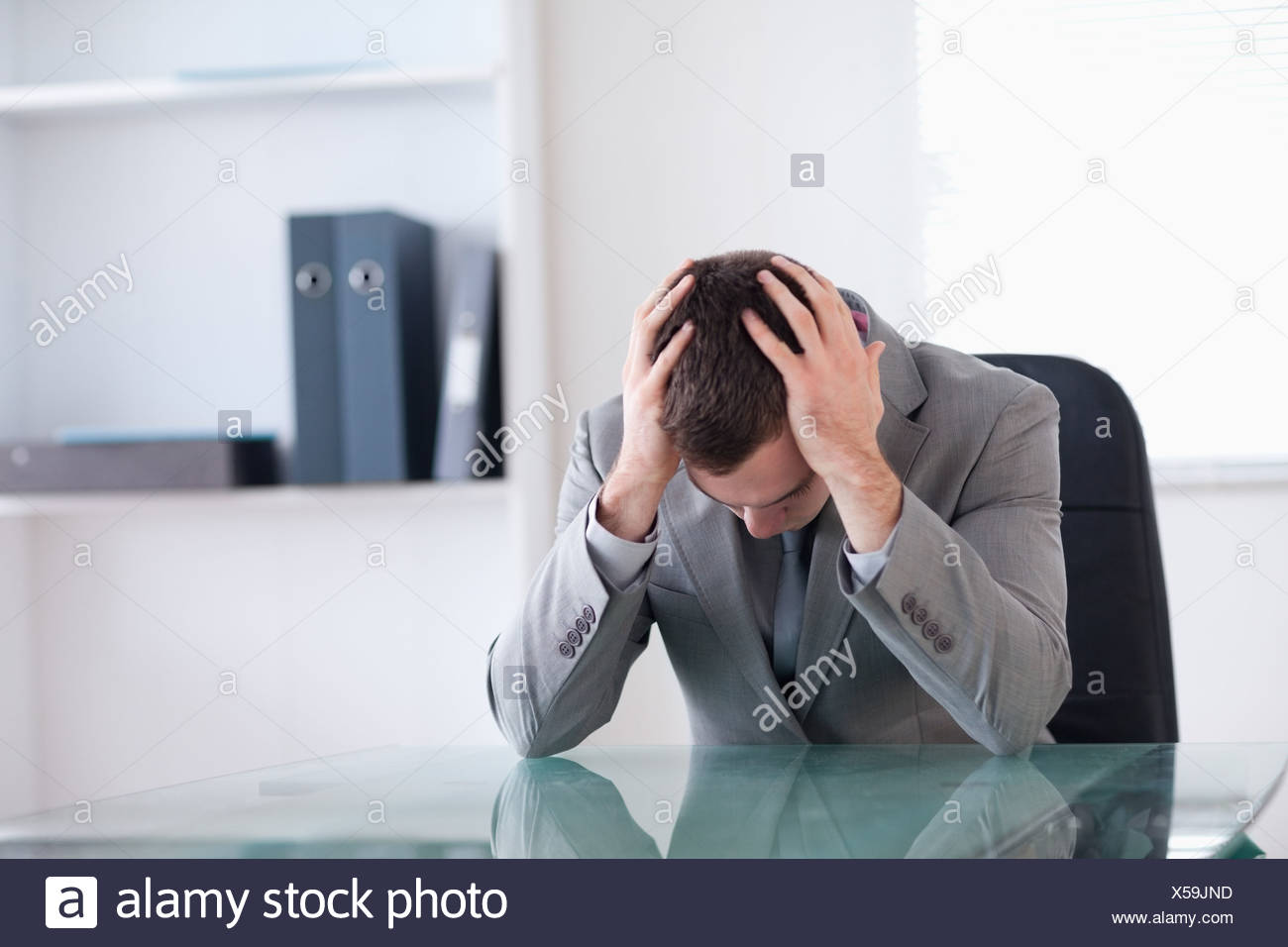 Businessman after failed negotiation - Stock Image