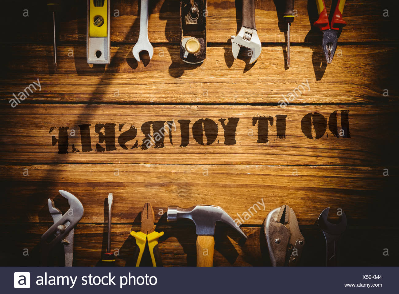 Do it yourself against desk with tools - Stock Image