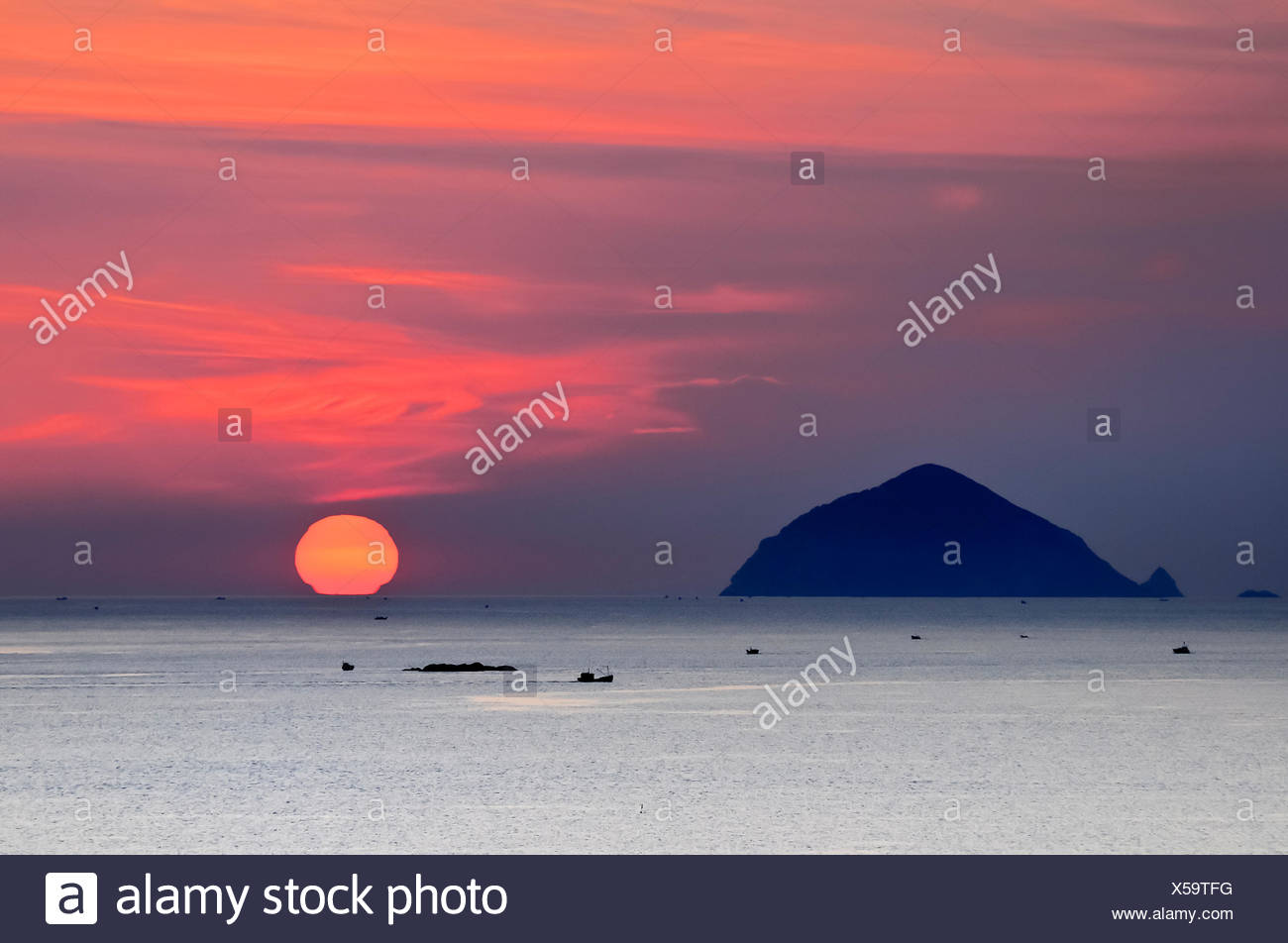 Sunset on the beach of Doc Let, Vietnam, Southeast Asia - Stock Image