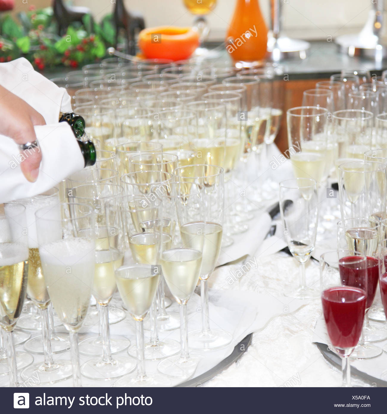 Serving champagne in the restaurant - Stock Image