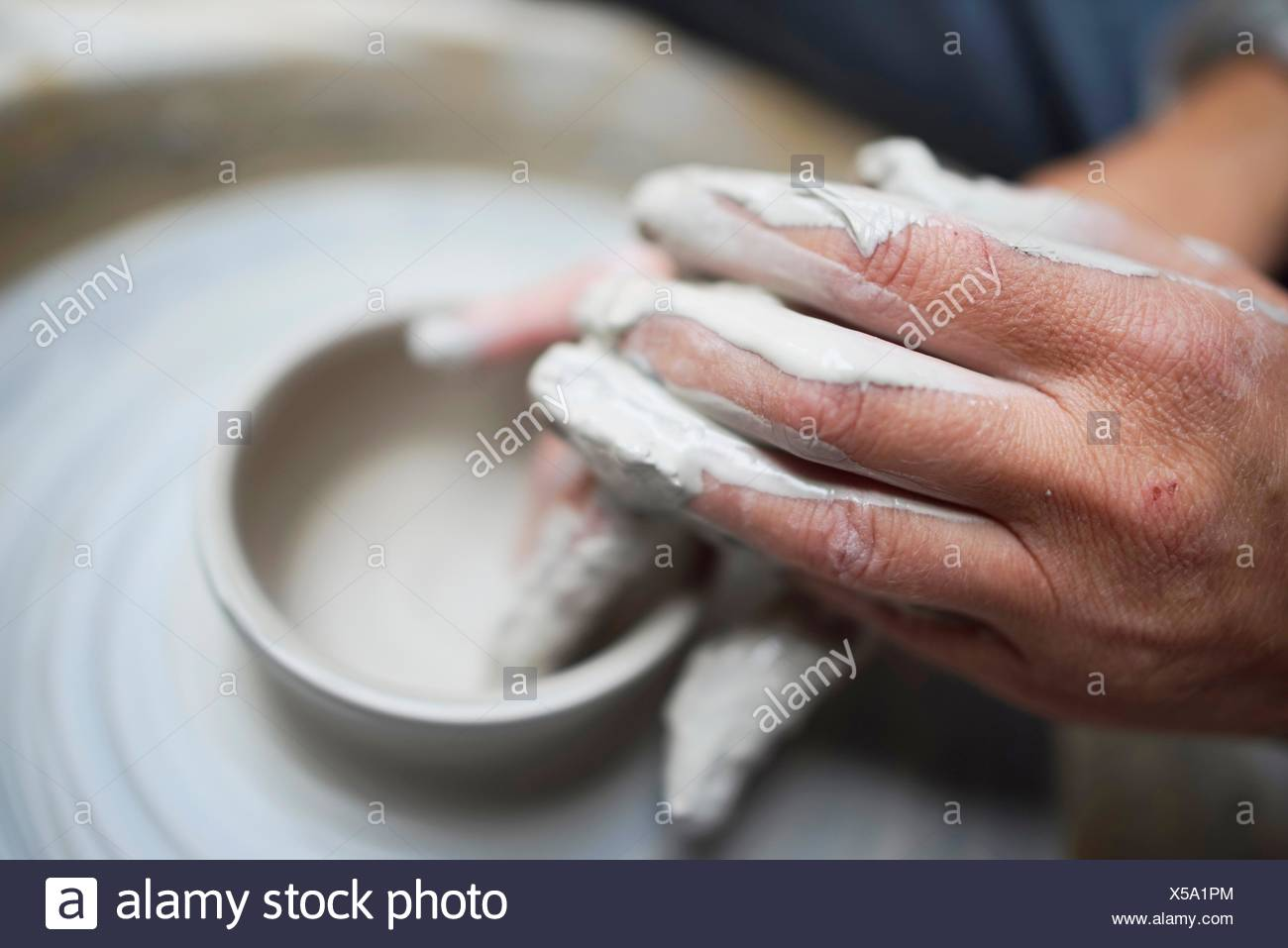 creative hands using clay to create pottery - Stock Image