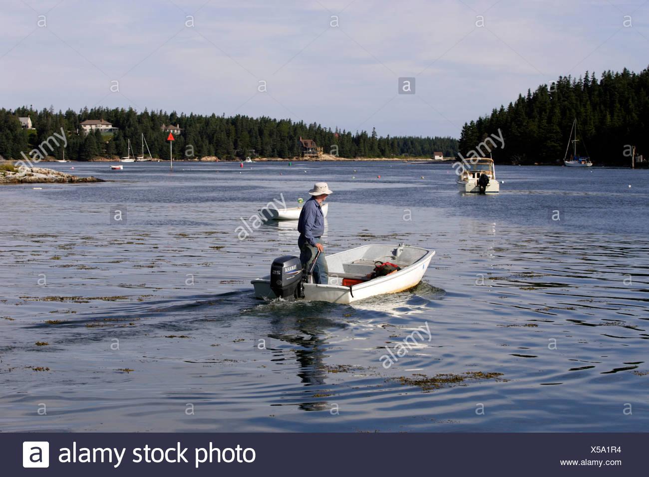 Man in dinghy, Isle au Haut, Arcadia National Park, Maine coast, New England, USA Stock Photo