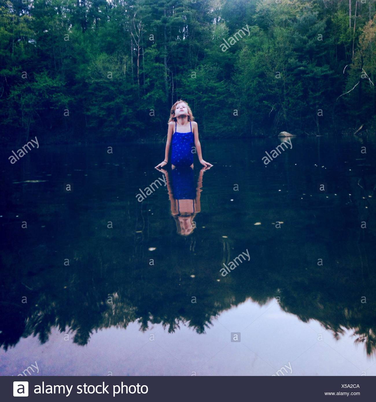 Girl In Swimwear At Lake - Stock Image