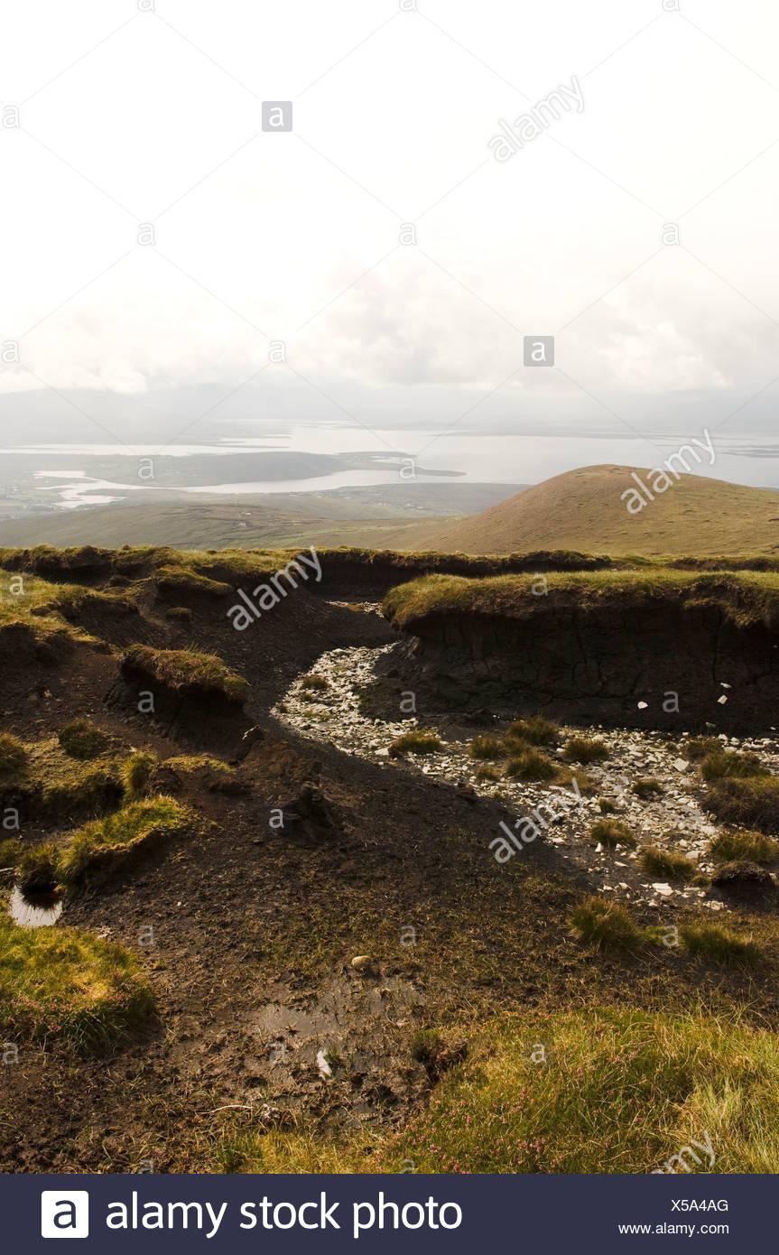 Republic of Ireland, County Mayo, Achill Island, turf banks - Stock Image