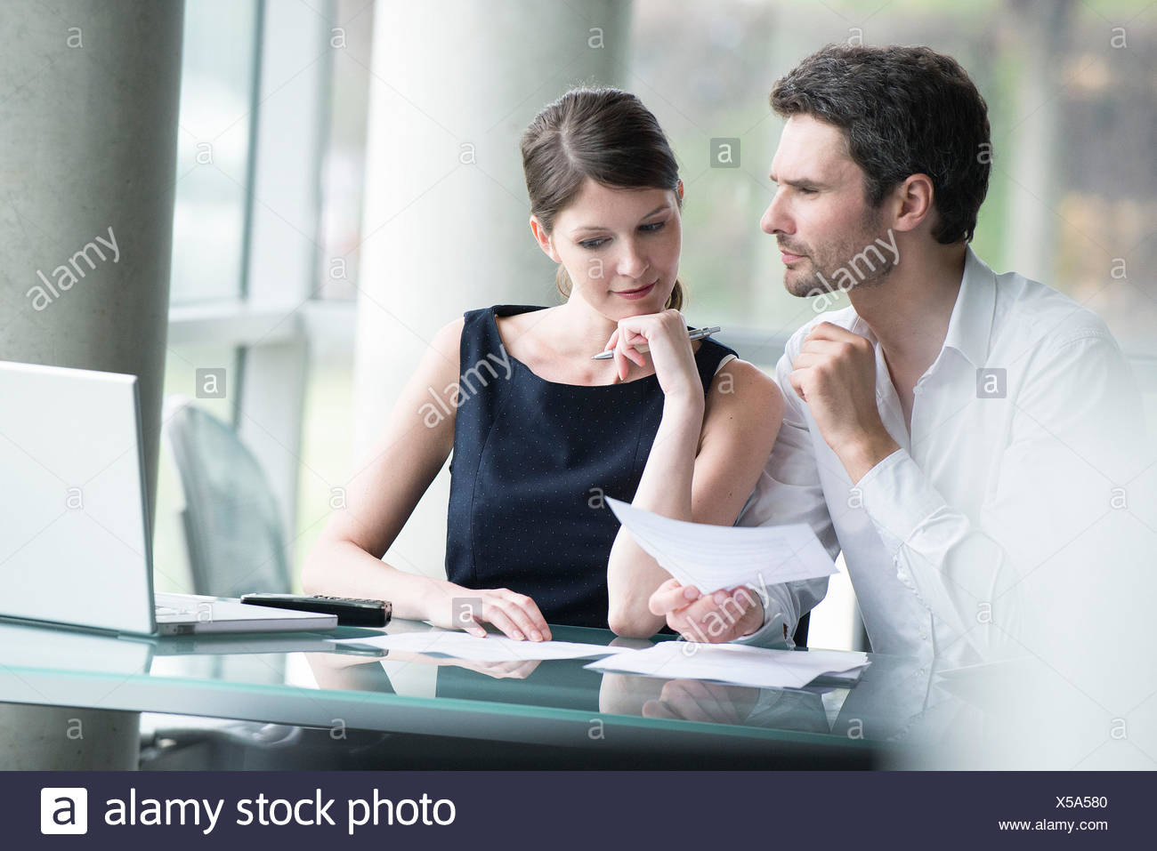 Business associates brainstorming - Stock Image