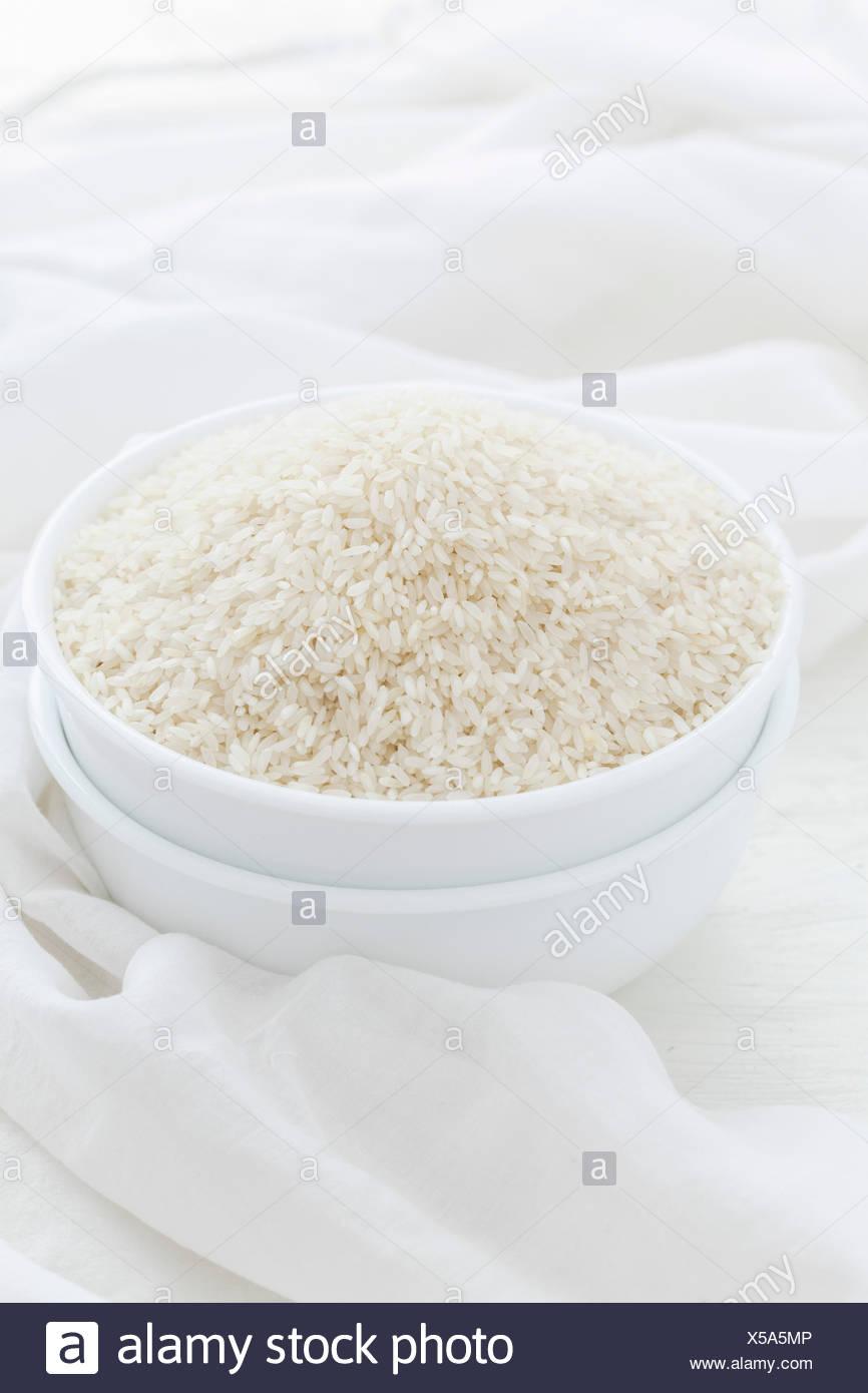 White Rice on White Background - Stock Image