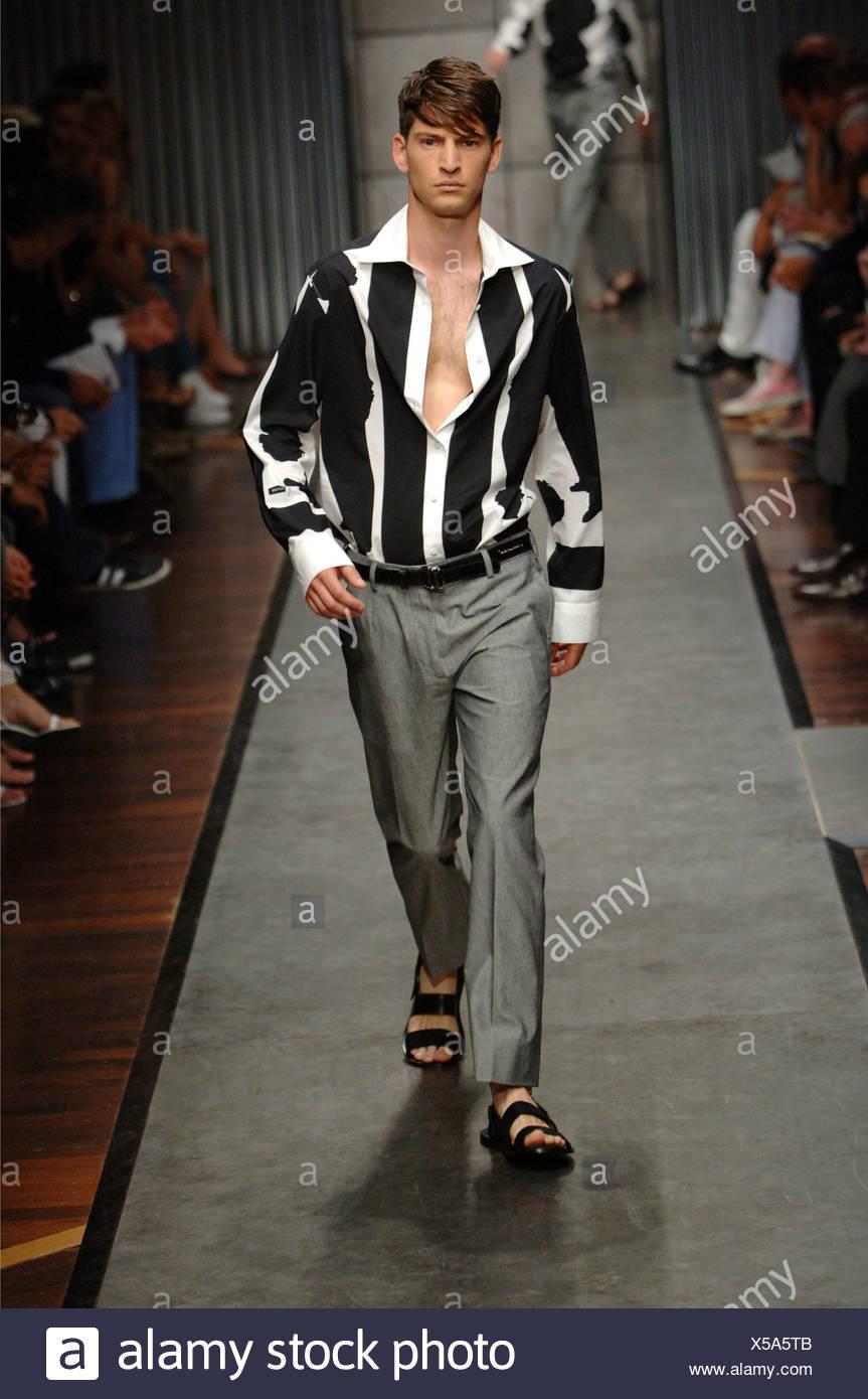 fa87eb7b8 Gianfranco Ferre Milan Ready to Wear Menswear Spring Summer Brunette male  model walking down the runway