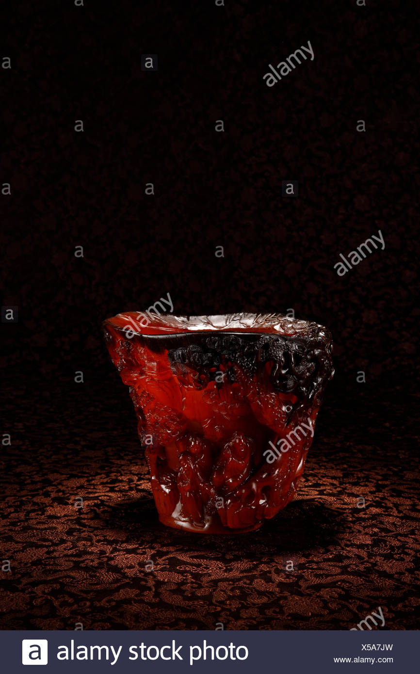 Rhino horn cup carved figures Stock Photo