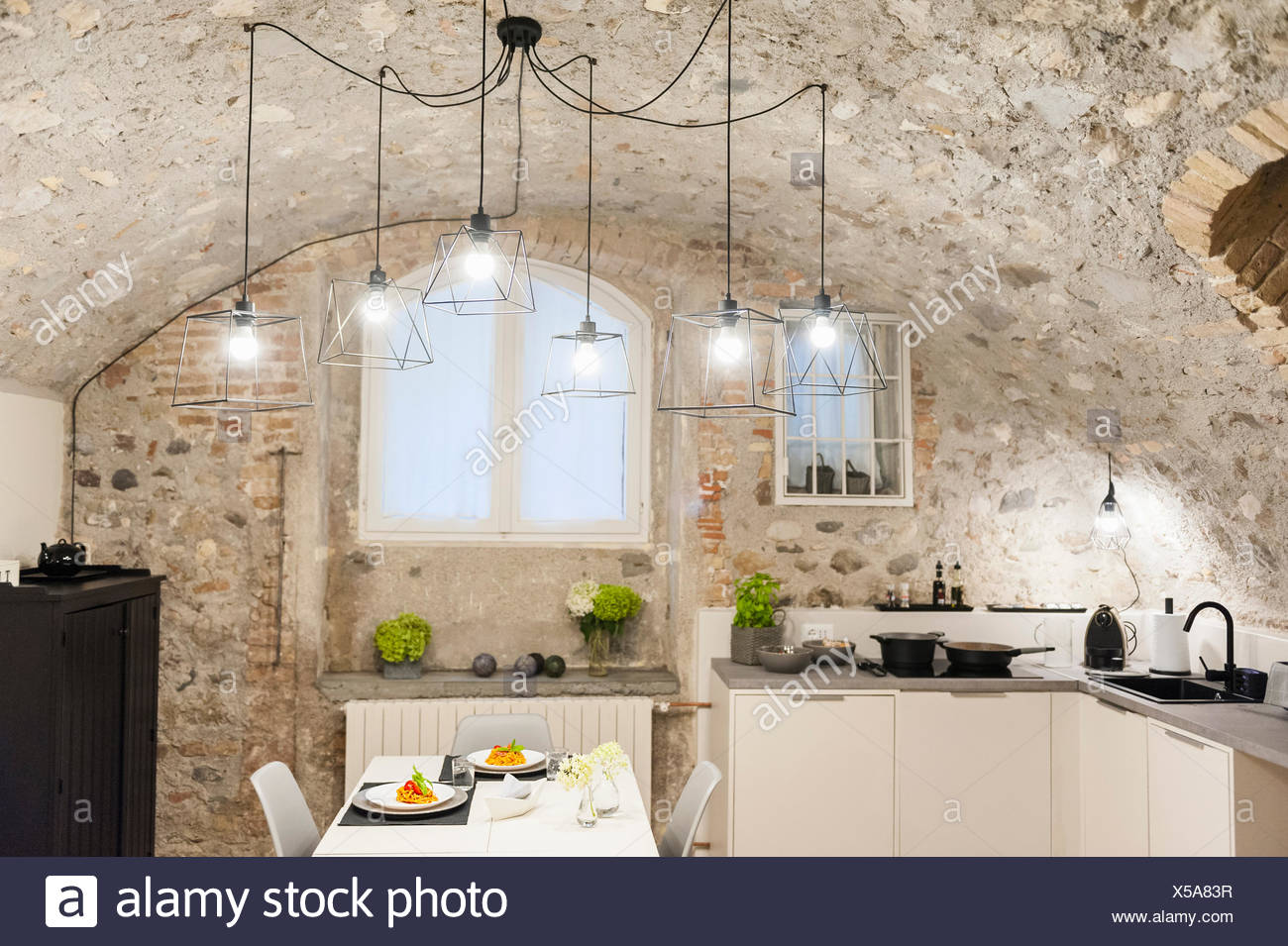 Modern Kitchen In Old Stone House With Freshly Cooked Pasta On Table Stock Photo Alamy