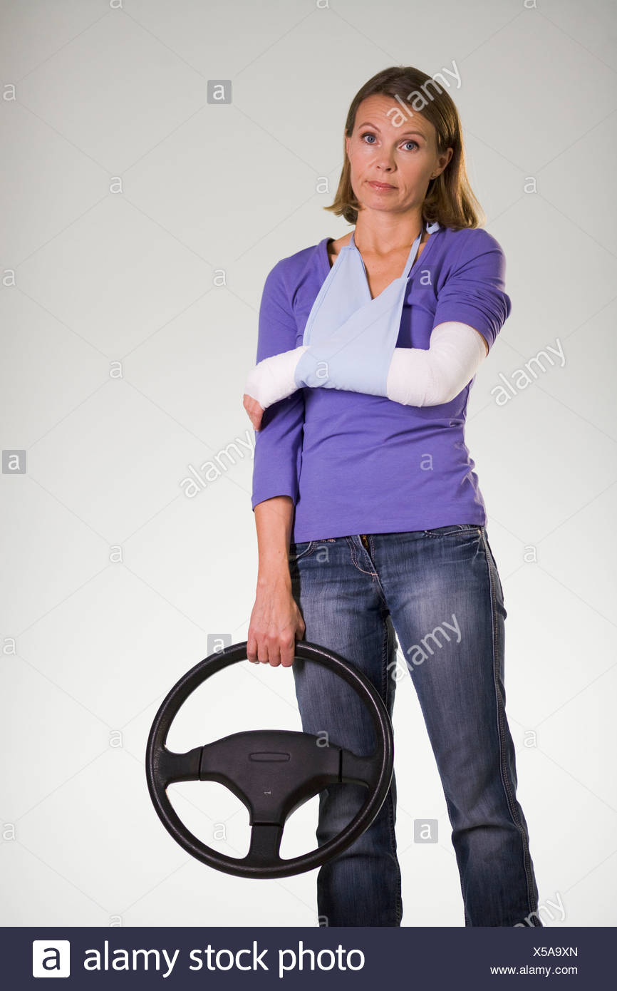A woman hurt in a car accident. - Stock Image