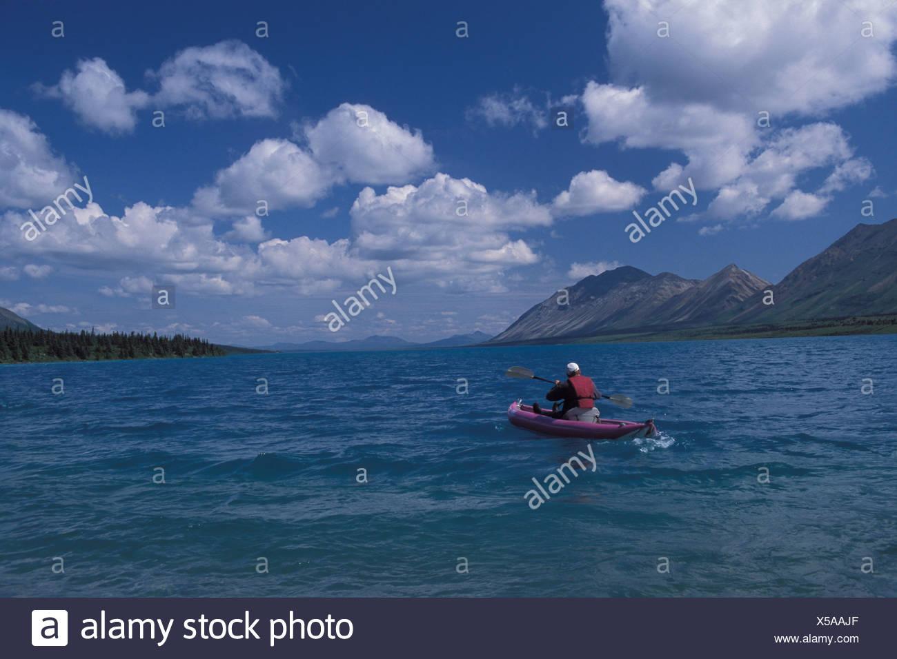 Kayaker Kayak Lake Clark national park Chigmit Mountains Alaska USA America United States North America wild - Stock Image